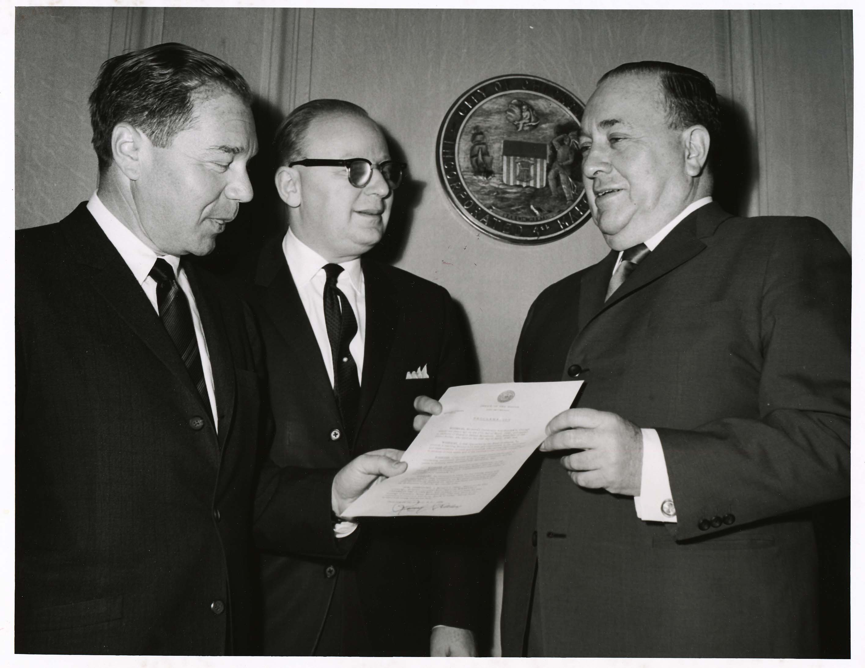Left to right: Jerome Stone, Rolf Weil, and Mayor Richard J. Daley with a proclamation proclaiming Roosevelt University Day, April 1966.  Photo by Chicago Photographers.